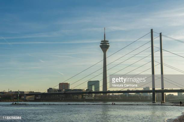 rhine river bank in düsseldorf, germany - beschaulichkeit stock pictures, royalty-free photos & images