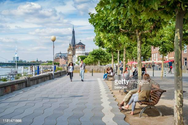 rhine river promenade in downtown dusseldorf germany - düsseldorf stock pictures, royalty-free photos & images