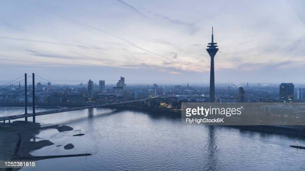 rhine tower and rhine river at dusk, duesseldorf, north rhine-westphalia, germany - düsseldorf stock pictures, royalty-free photos & images