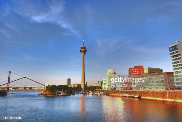 rhine tower in düsseldorf, germany - medienhafen stock-fotos und bilder