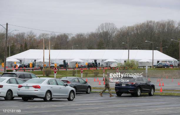 Rhode Island National Guard helps with the security at the first check point at the CVS rapid testing facility in the parking lot at Twin River...
