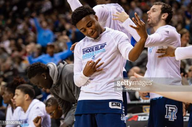 Rhode Island Rams bench reacts to a three point basket during the first half of the Atlantic 10 Tournament semifinal round college basketball game...