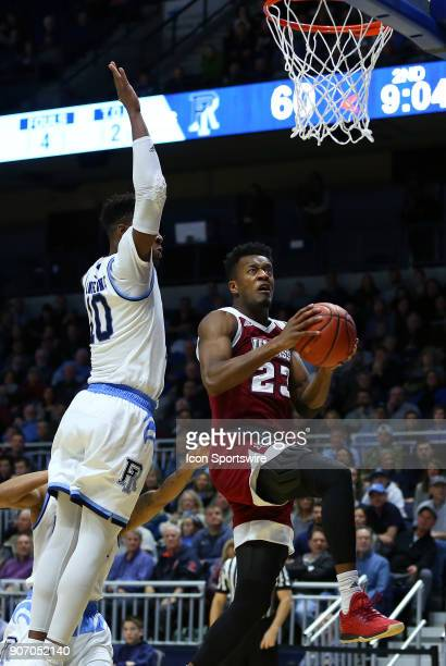 Rhode Island Rams forward Cyril Langevine defends UMass Minutemen guard CJ Anderson during a college basketball game between UMass Minutemen and...