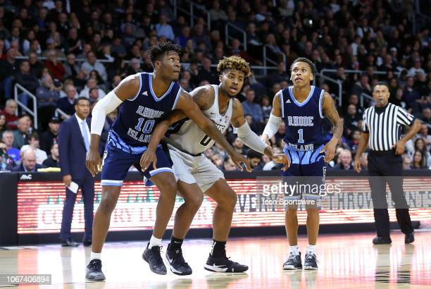 Rhode Island Rams forward Cyril Langevine Providence Friars center Nate Watson and Rhode Island Rams guard Fatts Russell during a college basketball...