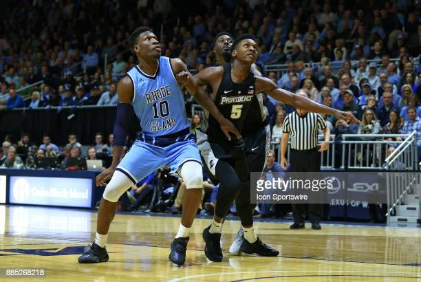 Rhode Island Rams forward Cyril Langevine Providence Friars forward Rodney Bullock and Providence Friars guard Isaiah Jackson in action during a...