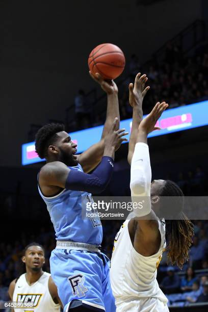 Rhode Island Rams forward Hassan Martin shoots over VCU Rams forward Mo AlieCox during the first half of a college basketball game between VCU Rams...
