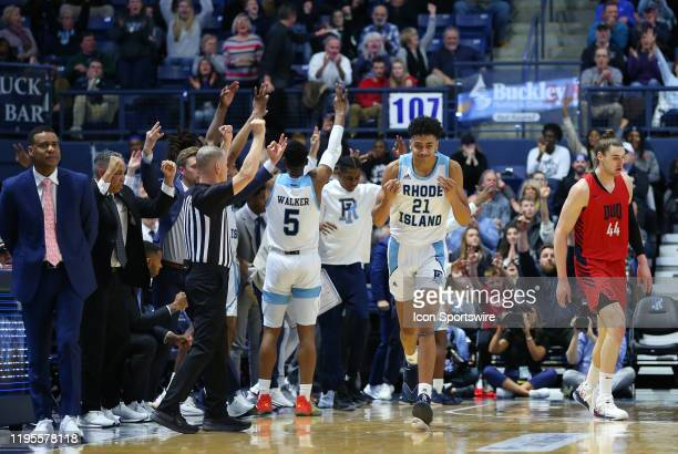 Rhode Island Rams forward Jacob Toppin and bench reacts after a three point shot during a college basketball game between Duquesne Dukes and Rhode...