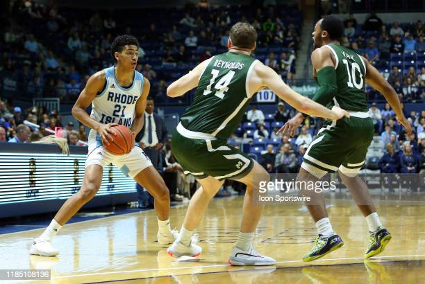 Rhode Island Rams forward Jacob Toppin defended by Manhattan Jaspers forward Tyler Reynolds and Manhattan Jaspers guard Nehemiah Mack during the...