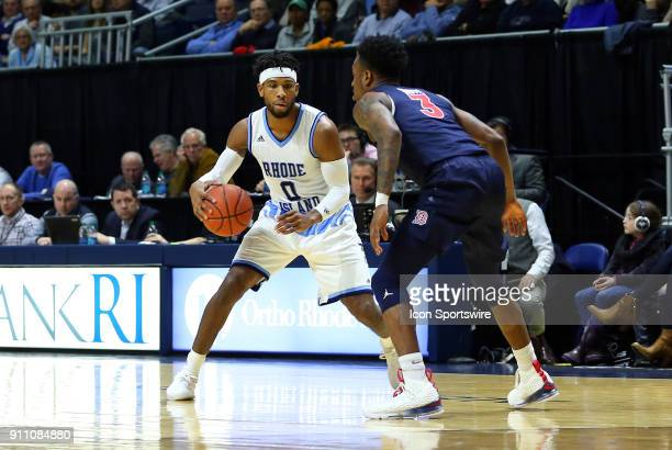 Rhode Island Rams guard EC Matthews defended by Duquesne Dukes guard Tarin Smith during a college basketball game between Duquesne Dukes and Rhode...