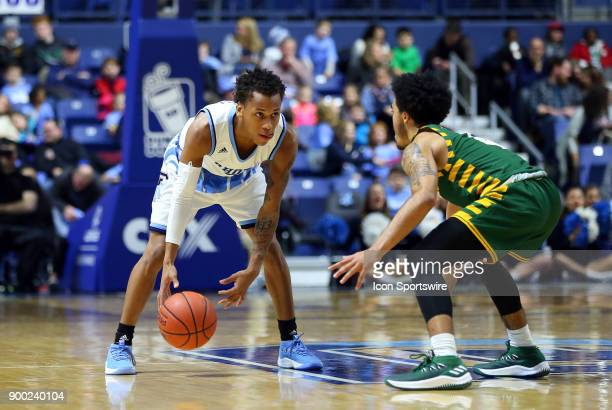 Rhode Island Rams guard Fatts Russell and George Mason Patriots guard Otis Livingston II in action during a college basketball game between George...