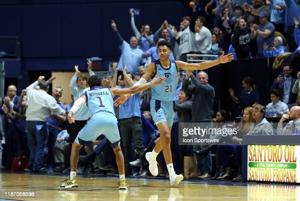 Rhode Island Rams guard Fatts Russell and Rhode Island Rams forward Jacob Toppin celebrate during a college basketball game between Providence Friars...