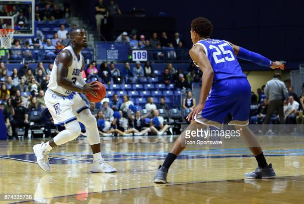 Rhode Island Rams guard Jared Terrell and UNC Asheville Bulldogs guard MaCio Teague in action during a college basketball game between UNC Asheville...