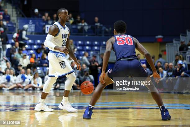 Rhode Island Rams guard Jared Terrell defended by Duquesne Dukes guard Eric Williams Jr during a college basketball game between Duquesne Dukes and...