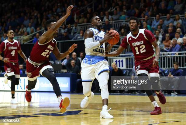 Rhode Island Rams guard Jared Terrell drives to the basket between UMass Minutemen guard CJ Anderson and UMass Minutemen guard Carl Pierre during a...