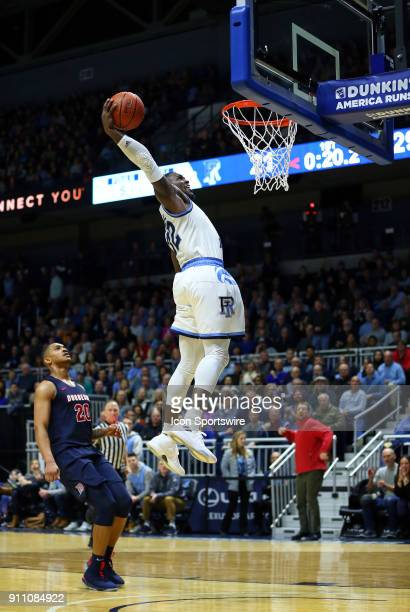 Rhode Island Rams guard Jared Terrell goes in for the dunk as Duquesne Dukes forward Kellon Taylor looks on during a college basketball game between...