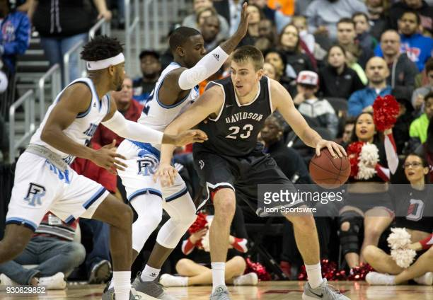 Rhode Island Rams guard Jared Terrell guards Davidson Wildcats forward Peyton Aldridge under the basket during the final of the 2018 Atlantic 10...