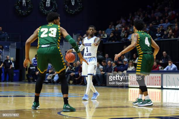 Rhode Island Rams guard Jarvis Garrett directs the offense while defended by George Mason Patriots guard Javon Greene and George Mason Patriots guard...