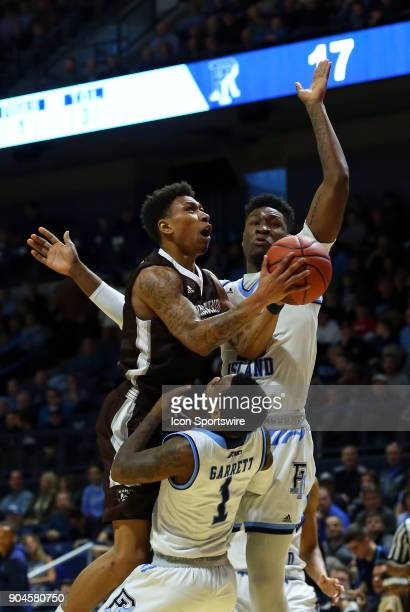 Rhode Island Rams guard Jarvis Garrett picks up the offensive foul against St Bonaventure Bonnies guard Jaylen Adams who is defended by Rhode Island...