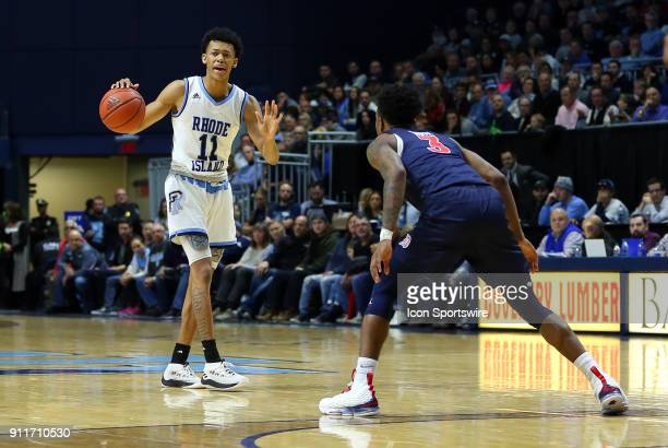 Rhode Island Rams guard Jeff Dowtin defended by Duquesne Dukes guard Tarin Smith during a college basketball game between Duquesne Dukes and Rhode...