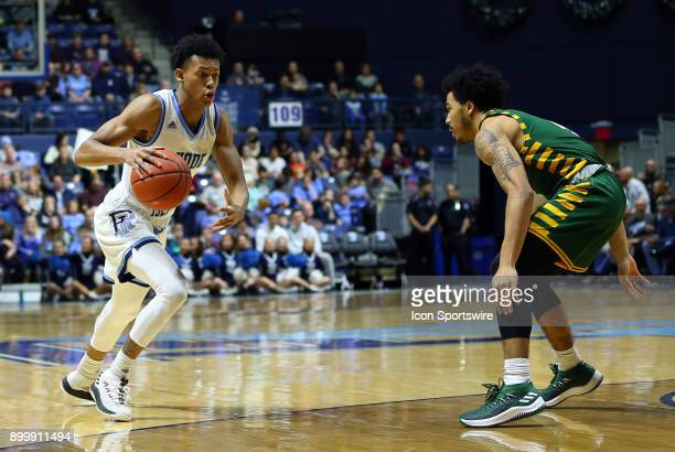 Rhode Island Rams guard Jeff Dowtin defended by George Mason Patriots guard Otis Livingston II during a college basketball game between George Mason...
