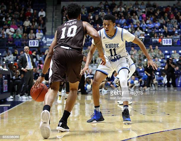 Rhode Island Rams guard Jeff Dowtin defends St Bonaventure Bonnies guard Jaylen Adams during the first half of a college basketball game between St...