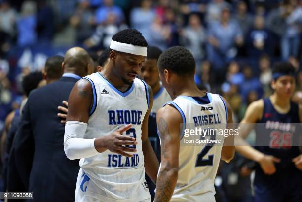 Rhode Island Rams guard Stanford Robinson celebrates with Rhode Island Rams guard Fatts Russell at the conclusion of the college basketball game...