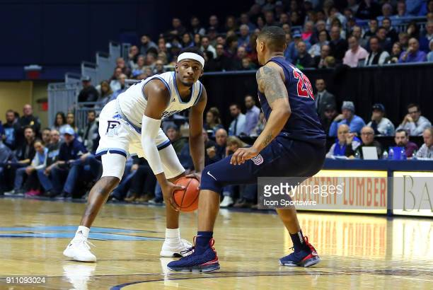 Rhode Island Rams guard Stanford Robinson defended by Duquesne Dukes forward Kellon Taylor during a college basketball game between Duquesne Dukes...