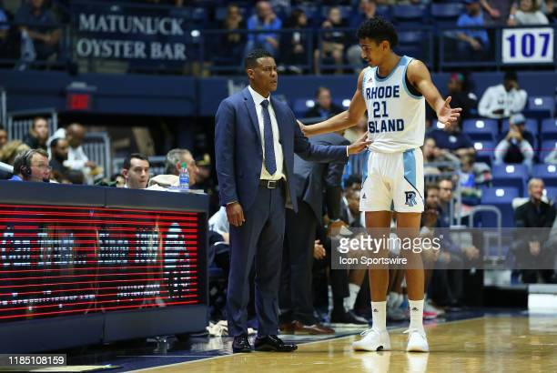 Rhode Island Rams head coach David Cox speaks with Rhode Island Rams forward Jacob Toppin during the college basketball game between Manhattan...