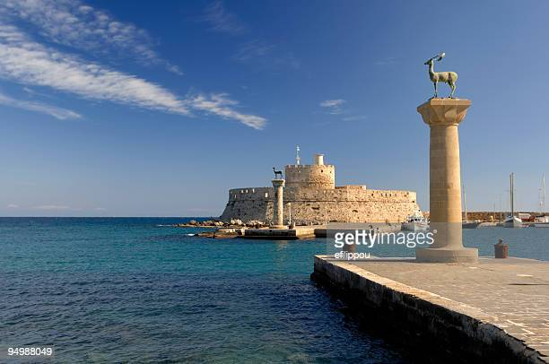 rhodes landmark mandraki port - local landmark stock pictures, royalty-free photos & images