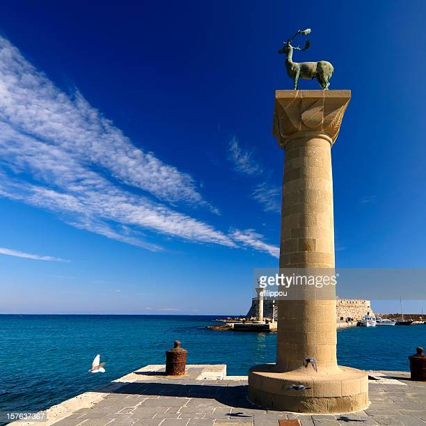rhodes mandraki port entry - rhodes dodecanese islands stock photos and pictures
