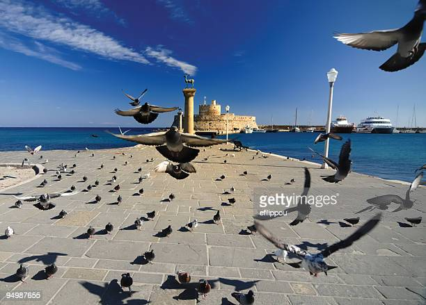 rhodes mandraki port - colossus stock photos and pictures