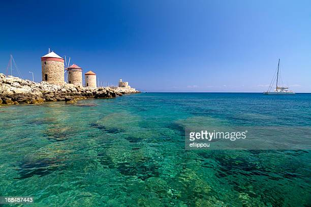 rhodes mandraki windmills - rhodes dodecanese islands stock photos and pictures