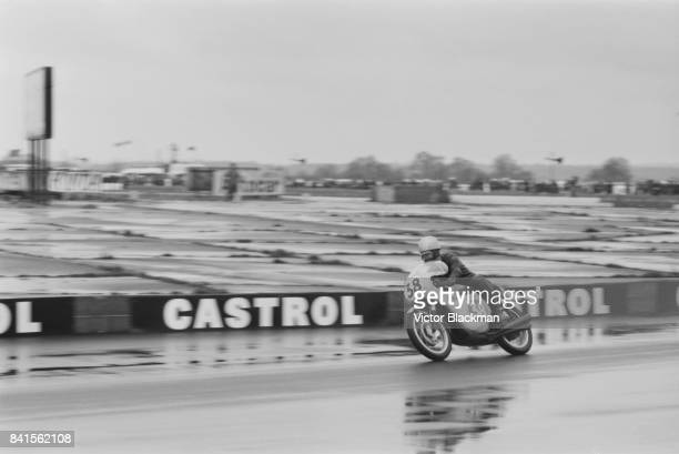 Rhodesian professional motorcycle racer Jim Redman drives 350cc Honda at Silverstone Circuit UK 6th April 1964