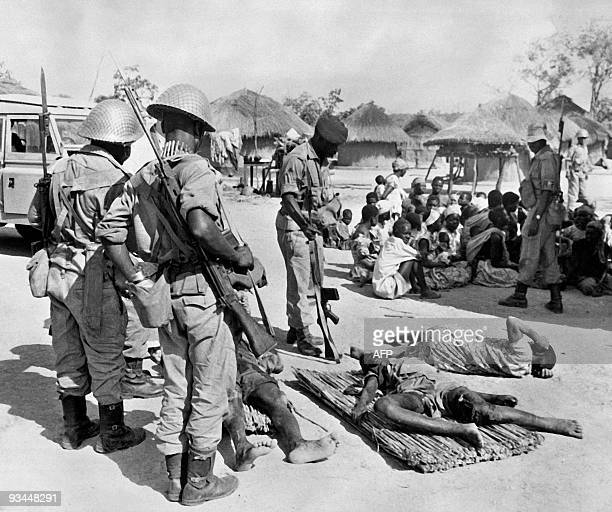 Rhodesian soldiers stand next to prisoners and wounded Lumpas after a fight between the Lumpa Church of Alice Lenshina and governmental army August 7...
