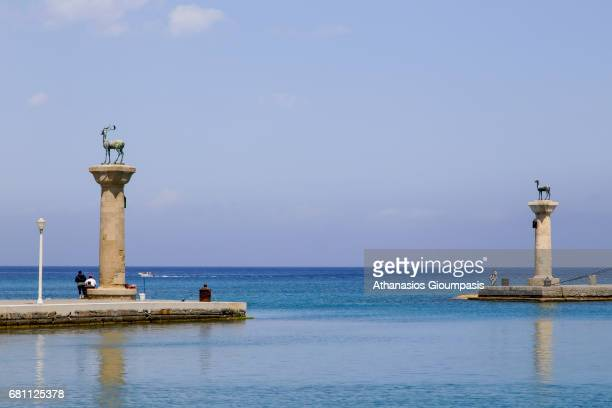 Rhodian Deer Statues at Mandraki Harbor entrance on May 06 2017 in Rhodes Greece Sculptures of Rhodian Deer a stag and a doe stand on slim columns on...