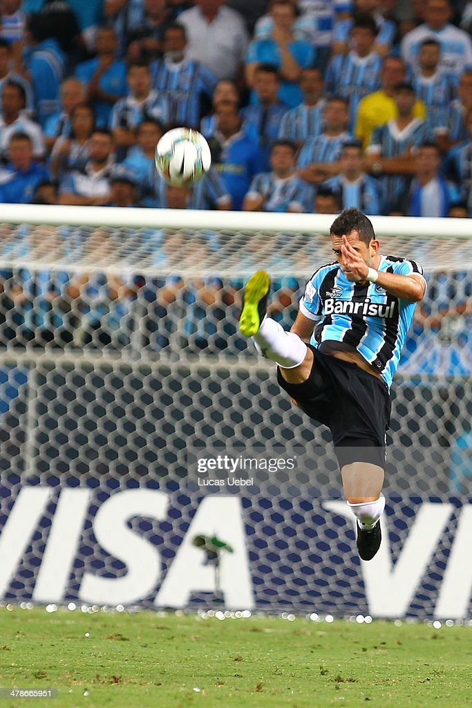 Rhodolfo of Gremio runs for the ball during the Copa Bridgestone Libertadores 2014 match between Gremio v Newell's Old Boys (ARG) at Arena do Gremio Stadium on March 13, 2014 in Porto Alegre, Brazil.