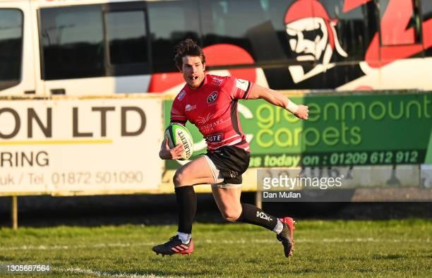 Rhodri Davies of Cornish Pirates runs in to score his side's third try during the Greene King IPA Championship match between Cornish Pirates and...