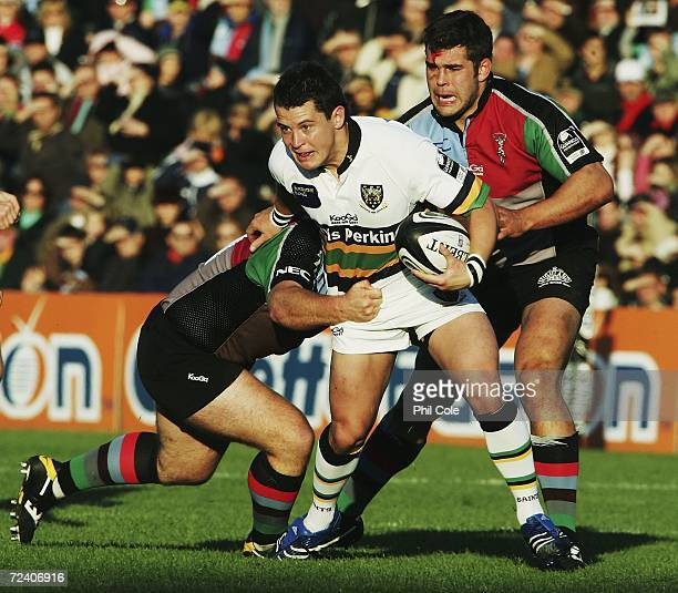 Rhodri Davies of Northamton Saints gets tackled by Ceri Jones of Harlequins during the Guinness Premiership rugby match between Harlequins and...