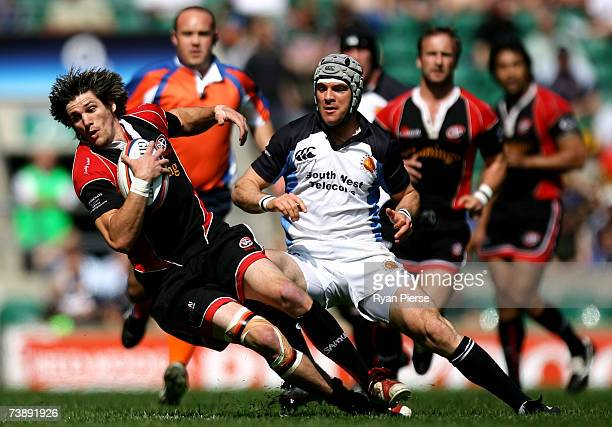 Rhodri McAtee of Cornish Pirates is tackled by Kevin Barrett of Exeter during the EDF Energy National Trophy match between Cornish Pirates and Exeter...