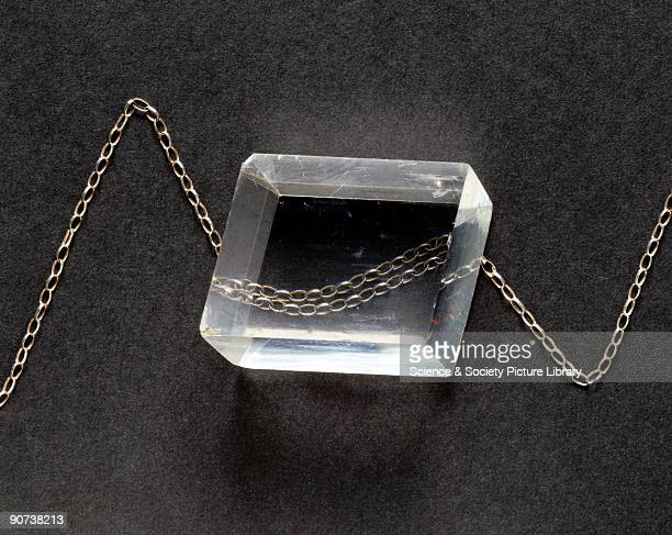 Rhomboidal crystal of Iceland spar, a mineral that is also known as calcite. It strongly exhibits double refraction, a phenomenon also known as...