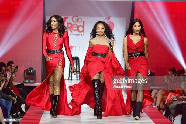 Rhona Bennett Terry Ellis and Cindy HerronBraggs of En Vogue walk the runway during the American Heart Association's Go Red For Women Red Dress...