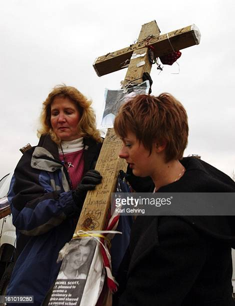 Rhonda Erdman left and Valerie Haile carried a cross into Clement Park where it was put on display on the third anniversary of the Columbine High...