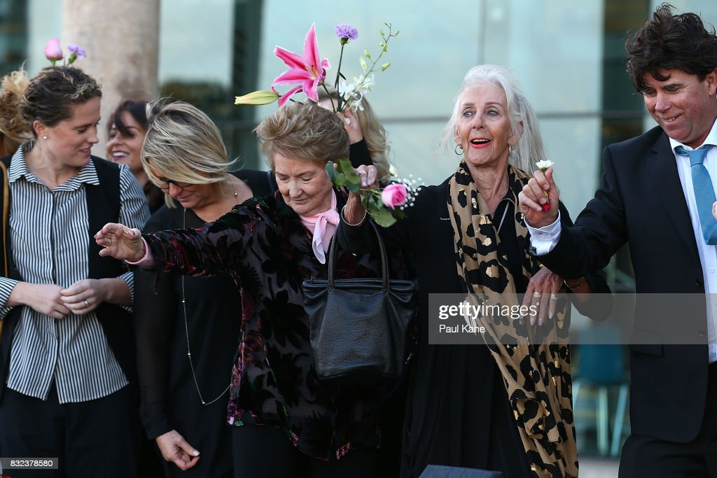 Rhonda Gillam and Marie Johnston throw flowers into the esturay following the funeral service for Betty Cuthbert at Mandurah Performing Arts Centre on August 16, 2017 in Mandurah, Australia. Betty Cuthbert was known as 'The Golden Girl' at the 1956 Melbourne Olympics, winning the 100m, 200m and 4x100m relay. After sustaining an injury at the Rome Olympics in 1960, Cuthbert came out of a short-lived retirement to win her fourth Olympic gold medal in the 400m at the 1964 Tokyo Olympic Games. Betty Cuthbert passed away on 6 August 2017, aged 79.