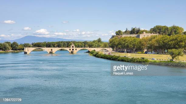 rhone river and pont d'avignon, also known as pont saint-benezet, over the rhone river in avignon, france - rhone stock pictures, royalty-free photos & images