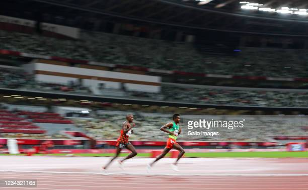 Rhonex Kipruto of Team Kenya and Solemn Barega of Ethiopia in the final of the Team mens 10000m during the Athletics event on Day 7 of the Team Tokyo...