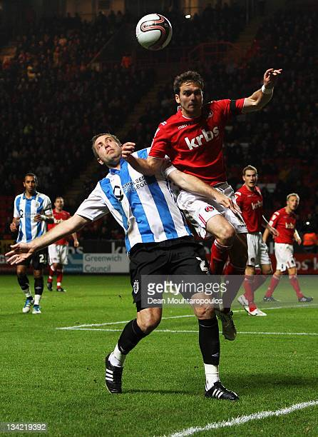 Rhoys Wiggins of Charlton and Jon Parkin of Huddersfield battle for the ball during the npower League One match between Charlton Athletic and...
