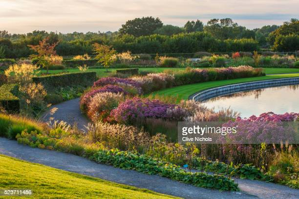 Rhs Garden, Wisley: Borders by tom Stuart - Smith Near The Lake - September, Evening Light, Stipa Gi