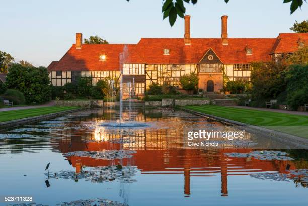 Rhs Garden, Wisley, Surrey: The house and Laboratory At Sunset Seen across The Canal from The Loggia
