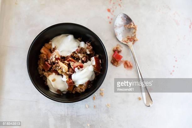 Rhubarb Strawberry Crumble with yogurt in a bowl, spoon