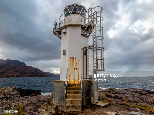 rhue lighthouse - moment of silence stock pictures, royalty-free photos & images